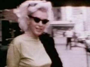 Marilyn leaves her apartment building for Madison Square Garden. (Screencap from footage by James Haspiel)
