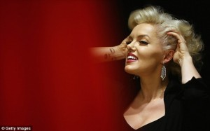 Impersonator Suzie Kennedy models earrings worn by Marilyn in 'How to Marry a Millionaire'