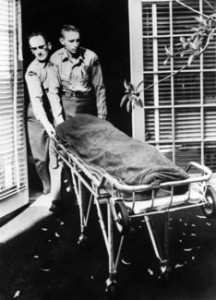 Marilyn's lifeless body is removed from her home on a gurney, August 5, 1962.