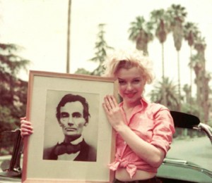 Great Americans: Marilyn holding her lithograph of Abraham Lincoln. Photo by Milton Greene, 1954