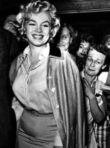 Marilyn leaves hospital in her much-loved silk coat, 1959
