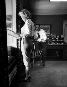 Marilyn discusses her role in 'Clash by Night' with Jerry Wald in his office. Photo by Bob Landry, September 1951.