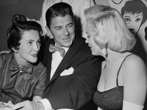 Marilyn chats with Reagan and wife Nancy, 1953