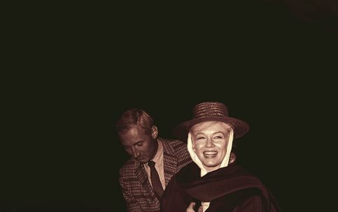 Marilyn is welcomed back to Reno by producer Frank Taylor after a hospital stay.