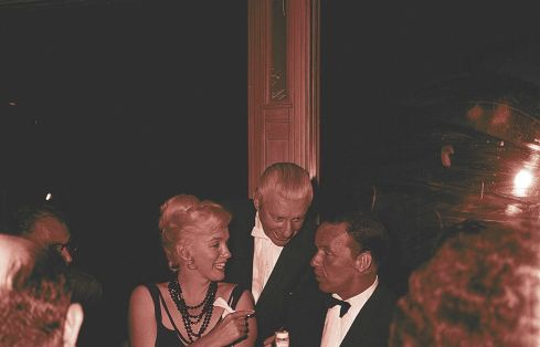 Marilyn chats with Frank Sinatra after a concert at the Cal-Neva Lodge, August 13. (Arthur Miller at left)
