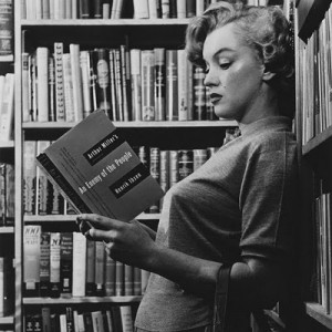 Marilyn poses for photographer Ben Ross, reading a play by Arthur Miller - shortly after their first meeting in 1951
