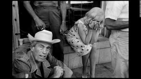 Director John Huston with Marilyn during filming of 'The Misfits', 1960