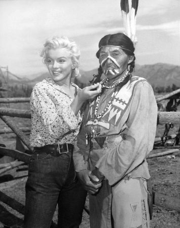 Marilyn with unnamed man during filming of 'River of No Return'